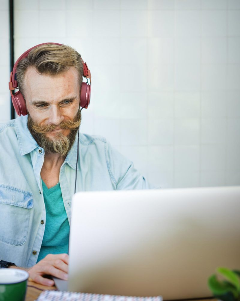 man-laptop-music-streaming-relaxation-technology-c-PNBQ7QB.jpg